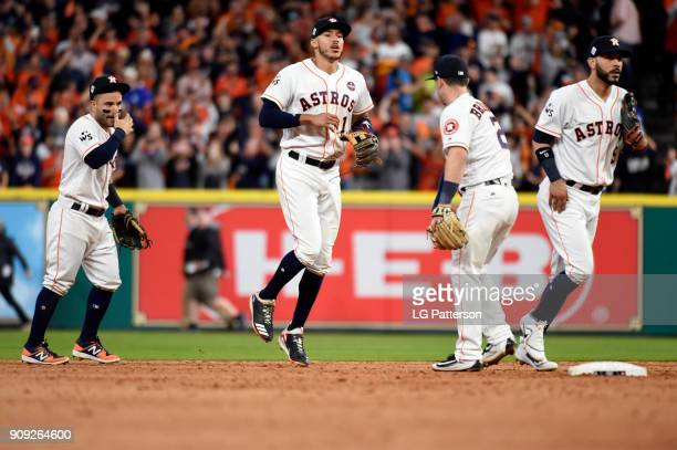 Jose Altuve Carlos Correa Alex Bregman and Marwin Gonzalez of the Houston Astros celebrate after the Astros defeated the Los Angeles Dodgers in Game...