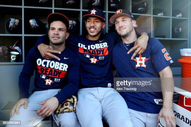 Jose Altuve Carlos Correa and Alex Bregman of the Houston Astros pose for a photo in the dugout prior to Game 1 of the 2017 World Series against the...