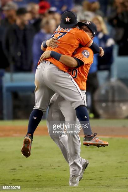 Jose Altuve celebrates with Juan Centeno of the Houston Astros after defeating the Los Angeles Dodgers 51 in game seven to win the 2017 World Series...