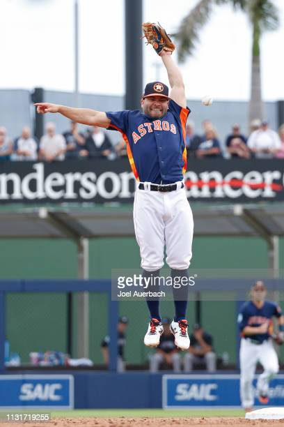 Jose Altuve is unable to catch the ball thrown by Alex Bregman of the Houston Astros in third inning action against the New York Yankees during a...