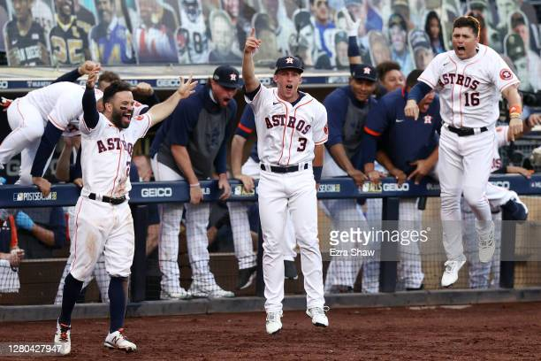 Jose Altuve, Myles Straw and Aledmys Diaz of the Houston Astros reacts to a Carlos Correa walk off home run to beat the Tampa Bay Rays 4-3 in Game...