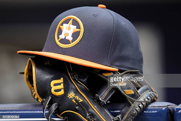 Jose Altuve of Houston Astros rests his hat and glove in the dugout before the game against the Milwaukee Brewers at Miller Park on April 10 2016 in...