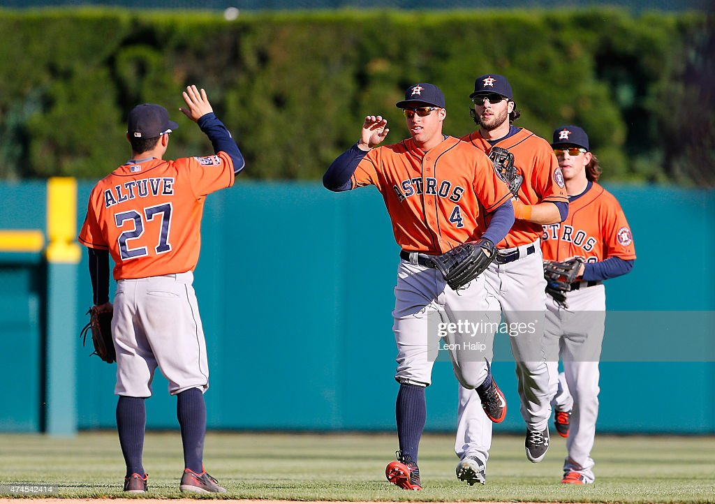 Jose Altuve #27 of the Houston Astros and teammate George Springer #4 celebrate a win over the Detroit Tigers on May 23, 2015 at Comerica Park in Detroit, Michigan. The Astros defeated the Tigers 3-2.