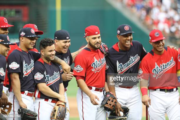 Jose Altuve of the Houston Astros and the American League and Eugenio Suarez of the Cincinnati Reds and the National League joke around during...