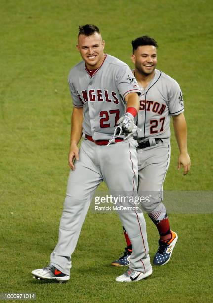 Jose Altuve of the Houston Astros and the American League and Mike Trout of the Los Angeles Angels of Anaheim and the American League react in the...