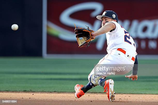 Jose Altuve of the Houston Astros and the American League fields a ball against the National League during the 87th Annual MLB AllStar Game at PETCO...