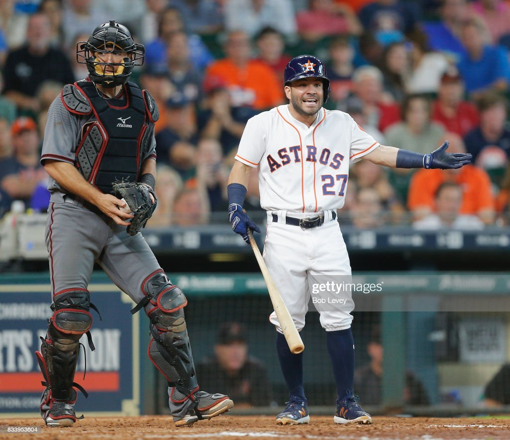 Jose Altuve #27 of the Houston Astros argues with first base umpire Ramon DeJesus called him out on a strike three check swing in the sixth inning at Minute Maid Park on August 17, 2017 in Houston, Texas.