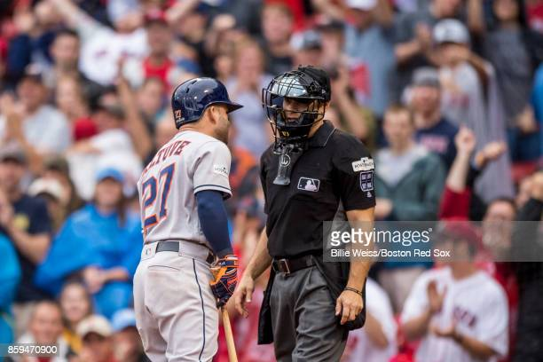 Jose Altuve of the Houston Astros argues with home plate umpire Mark Wegner during the seventh inning of game four of the American League Division...