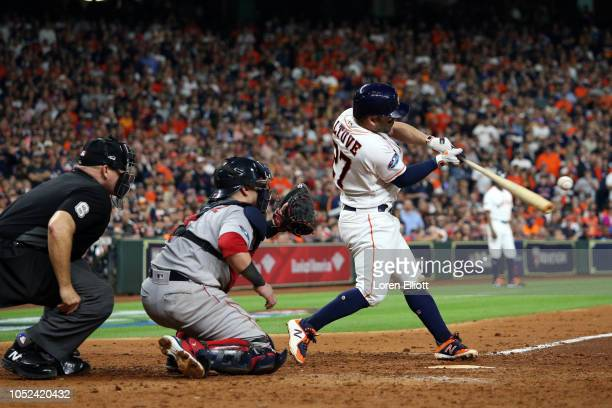 Jose Altuve of the Houston Astros bats during Game 4 of the ALCS against the Boston Red Sox at Minute Maid Park on Wednesday October 17 2018 in...