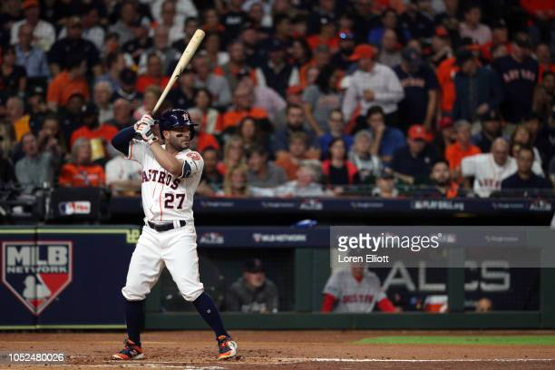Jose Altuve of the Houston Astros bats during Game 5 of the ALCS against the Boston Red Sox at Minute Maid Park on Thursday October 18 2018 in...