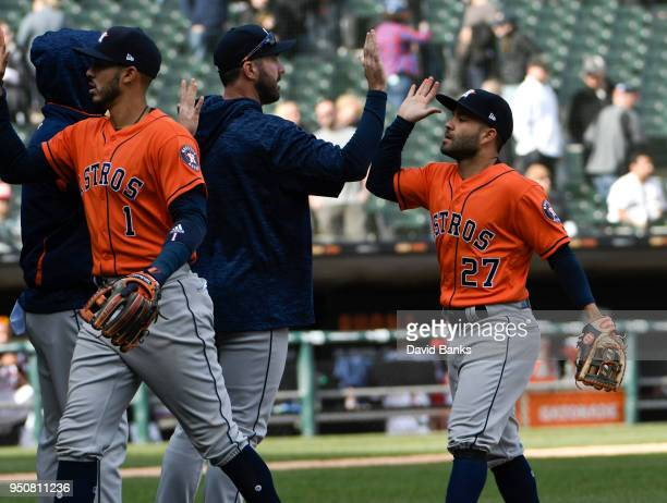 Jose Altuve of the Houston Astros Carlos Correa and Justin Verlander celebrate their win against the Chicago White Sox on April 22 2018 at Guaranteed...