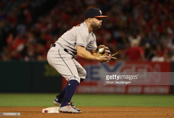 Jose Altuve of the Houston Astros catches the throw to second base in the middle of the fourth inning during the MLB game against the Los Angeles...