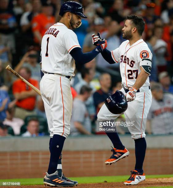 Jose Altuve of the Houston Astros celebrate with Carlos Correa after hitting a home run in the sixth inning against the Los Angeles Angels of Anaheim...