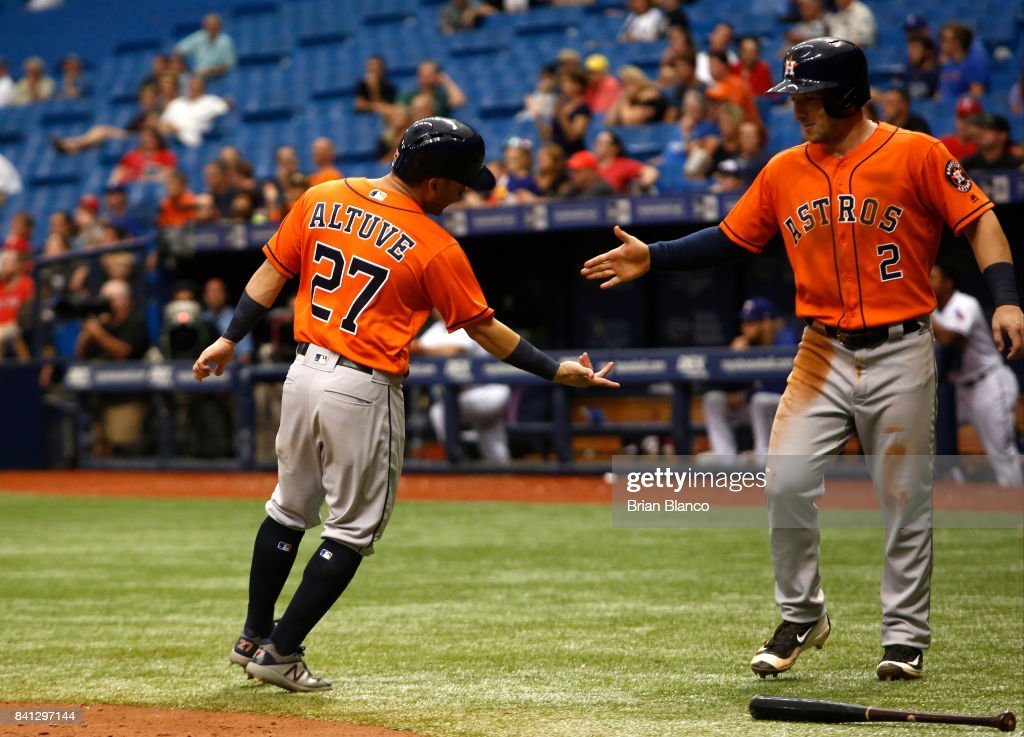 Jose Altuve #27 of the Houston Astros celebrate with teammate Alex Bregman #2 after both scoring off of a two-run single by Derek Fisher during the eighth inning of a game on August 31, 2017 at Tropicana Field in St. Petersburg, Florida.