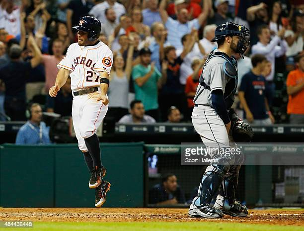 Jose Altuve of the Houston Astros celebrates after he scored a run in the eighth inning during their game against the Tampa Bay Rays at Minute Maid...