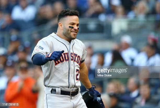 Jose Altuve of the Houston Astros celebrates after hitting a solo home run during the first inning against the New York Yankees in game three of the...