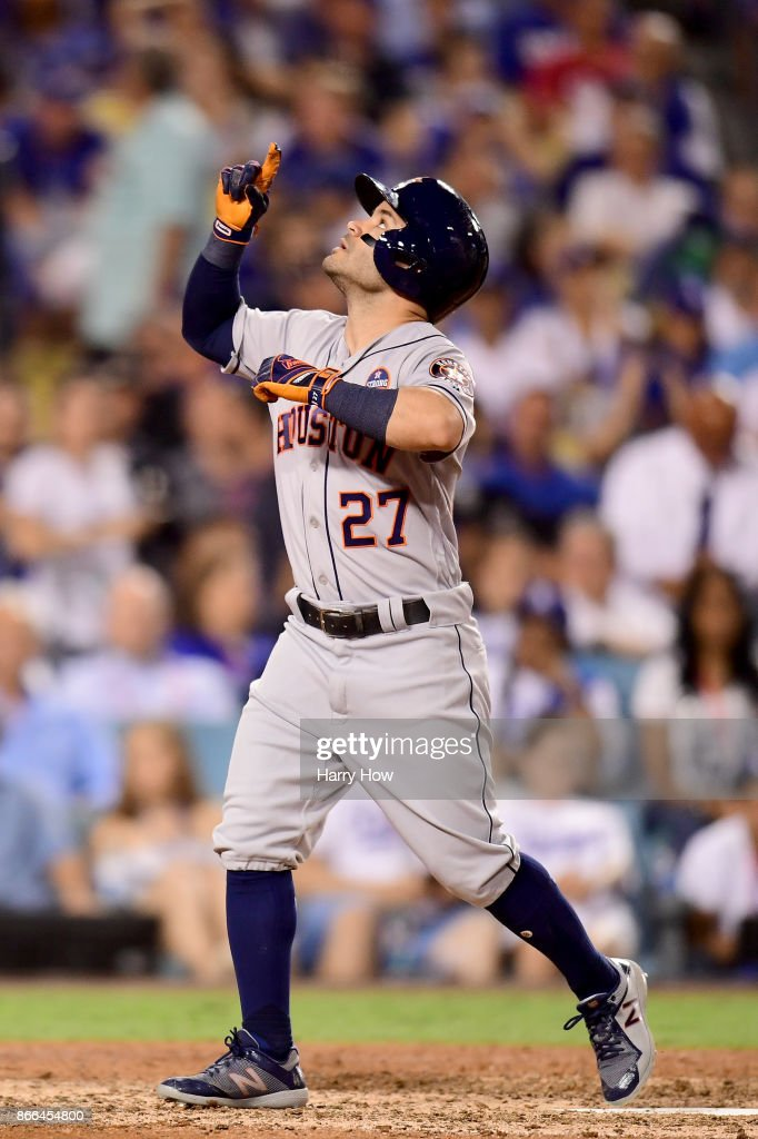 Jose Altuve #27 of the Houston Astros celebrates after hitting a solo home run during the tenth inning against the Los Angeles Dodgers in game two of the 2017 World Series at Dodger Stadium on October 25, 2017 in Los Angeles, California.