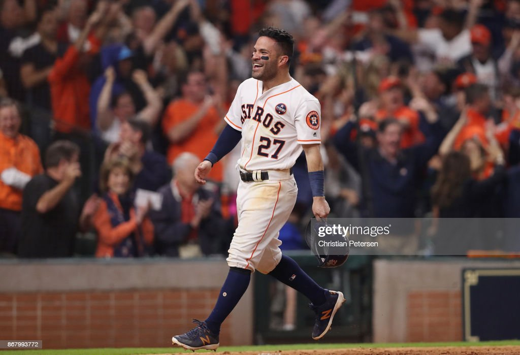 Jose Altuve #27 of the Houston Astros celebrates after scoring on a home run by Carlos Correa #1 (not pictured) during the seventh inning against the Los Angeles Dodgers in game five of the 2017 World Series at Minute Maid Park on October 29, 2017 in Houston, Texas.