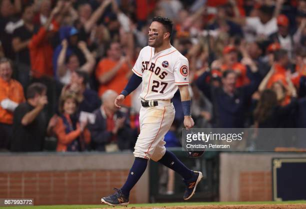 Jose Altuve of the Houston Astros celebrates after scoring on a home run by Carlos Correa during the seventh inning against the Los Angeles Dodgers...