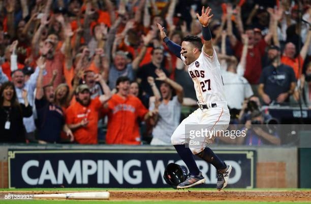 Jose Altuve of the Houston Astros celebrates after scoring the winning run in their 2-1 win over the New York Yankees during game two of the American...