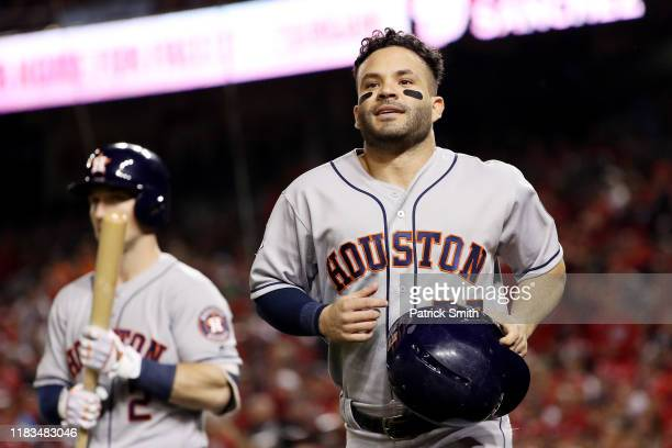 Jose Altuve of the Houston Astros celebrates as he comes home to score a run on a single by Michael Brantley against the Washington Nationals during...