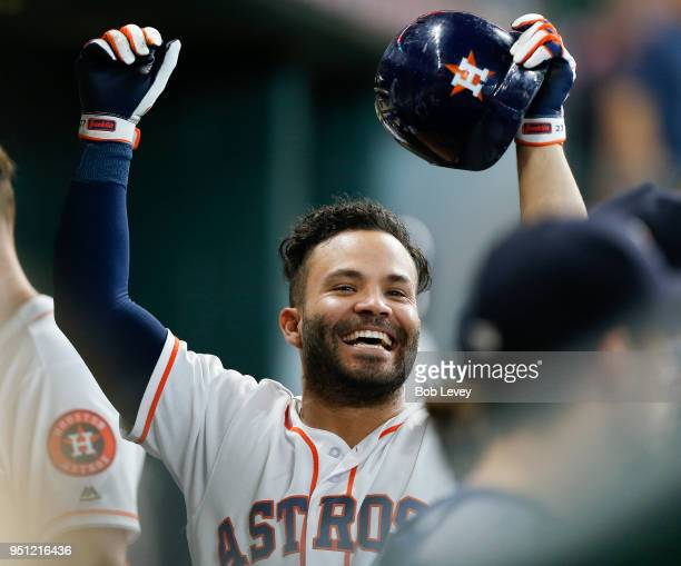 Jose Altuve of the Houston Astros celebrates by himself in the dugout after hitting a home run against the Los Angeles Angels of Anaheim in the sixth...