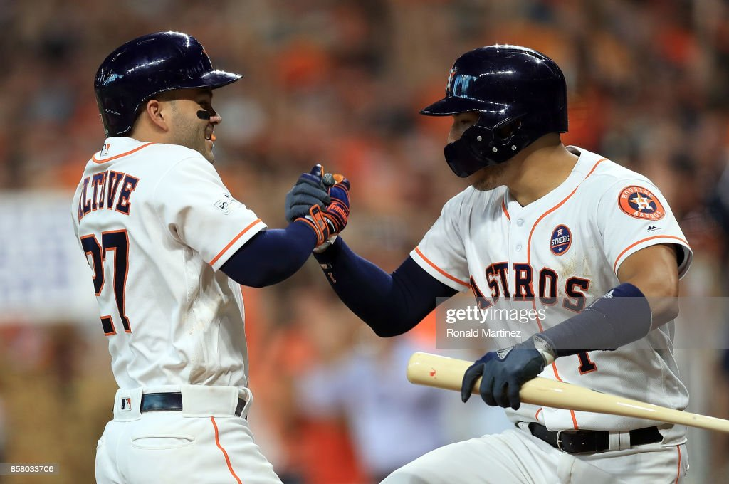 Jose Altuve #27 of the Houston Astros celebrates his third homerun of the game with Carlos Correa #1 during game one of the American League Division Series against the Boston Red Sox at Minute Maid Park on October 5, 2017 in Houston, Texas.