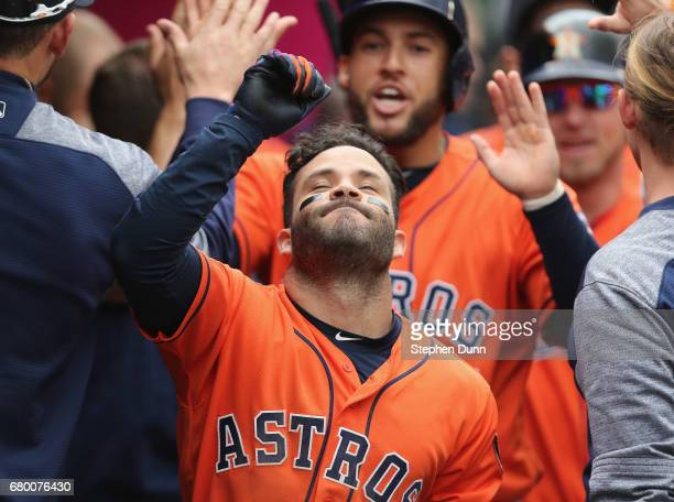 Jose Altuve of the Houston Astros celebrates in the dugout after hitting a three run home run in the third inning against the Los Angeles Angels of...