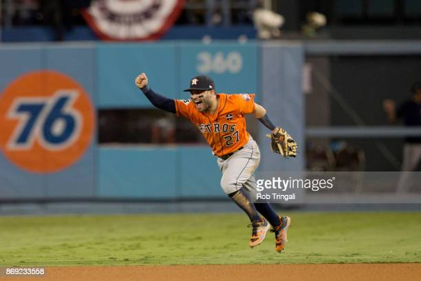 Jose Altuve of the Houston Astros celebrates on the field after the Astros defeated the Los Angeles Dodgers in Game 7 of the 2017 World Series at...