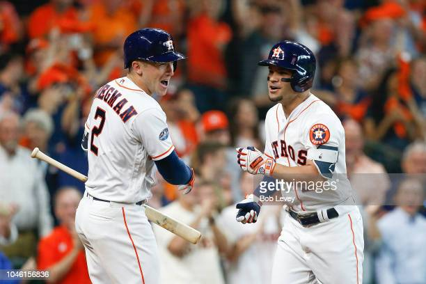 Jose Altuve of the Houston Astros celebrates with Alex Bregman after hitting a solo home run against Corey Kluber of the Cleveland Indians in the...