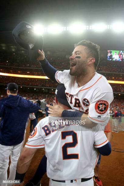 Jose Altuve of the Houston Astros celebrates with Alex Bregman after defeating the New York Yankees by a score of 40 to win Game Seven of the...