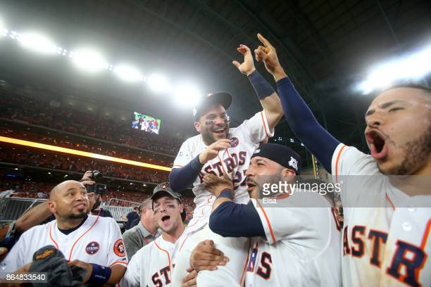 Jose Altuve of the Houston Astros celebrates with Alex Bregman Marwin Gonzalez and Carlos Correa after defeating the New York Yankees by a score of...