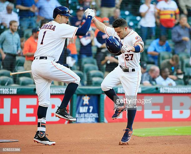 Jose Altuve of the Houston Astros celebrates with Carlos Correa after Altuve hit a home run in the first inning off Phil Hughes of the Minnesota...
