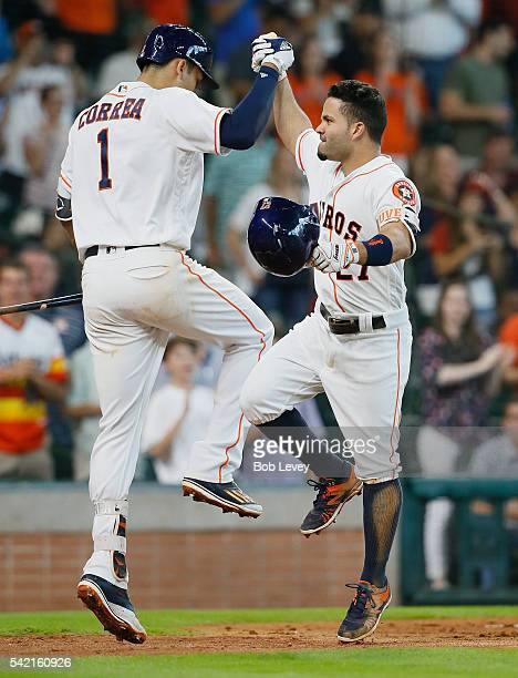 Jose Altuve of the Houston Astros celebrates with Carlos Correa after hitting a home run in the sixth inning against the Los Angeles Angels of...