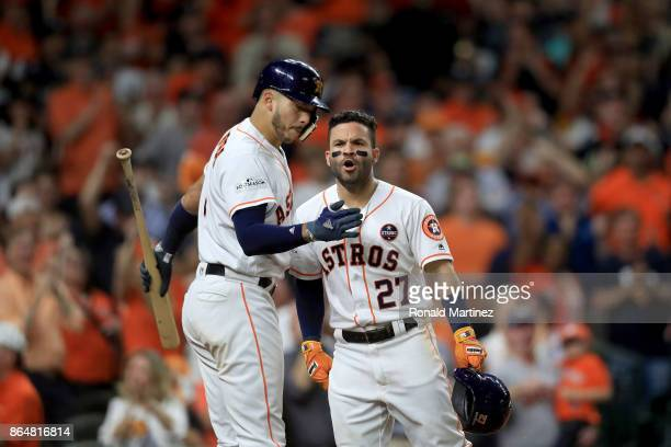 Jose Altuve of the Houston Astros celebrates with Carlos Correa after hitting a solo home run against Tommy Kahnle of the New York Yankees during the...