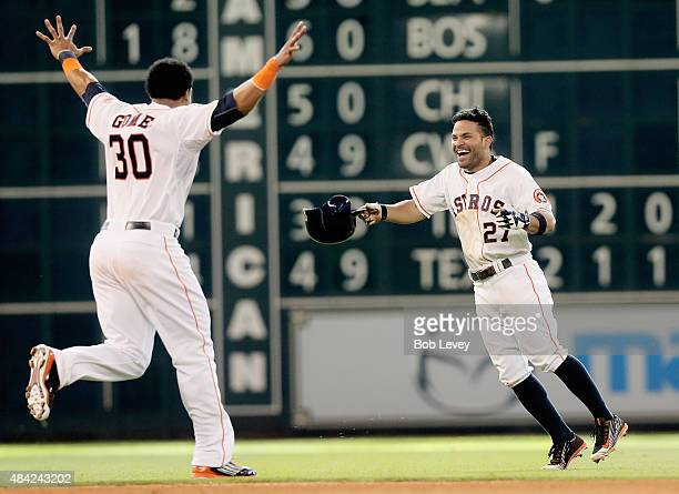 Jose Altuve of the Houston Astros celebrates with Carlos Gomez after hitting a walkoff single in the ninth inning to beat the Detroit Tigers 65 at...