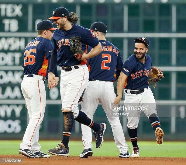 Jose Altuve of the Houston Astros celebrates with Jake Marisnick Alex Bregman and Myles Straw after the final out against the Seattle Mariners at...