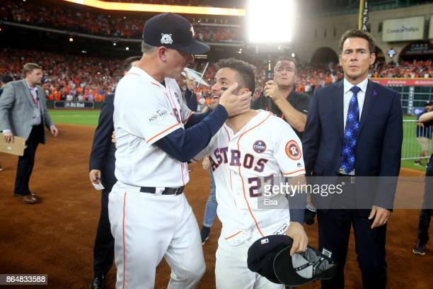 Jose Altuve of the Houston Astros celebrates with manager AJ Hinch after defeating the New York Yankees by a score of 40 to win Game Seven of the...