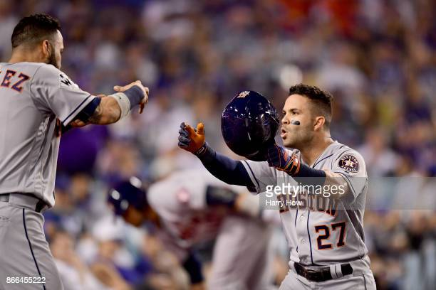 Jose Altuve of the Houston Astros celebrates with Marwin Gonzalez after hitting a solo home run during the tenth inning against the Los Angeles...