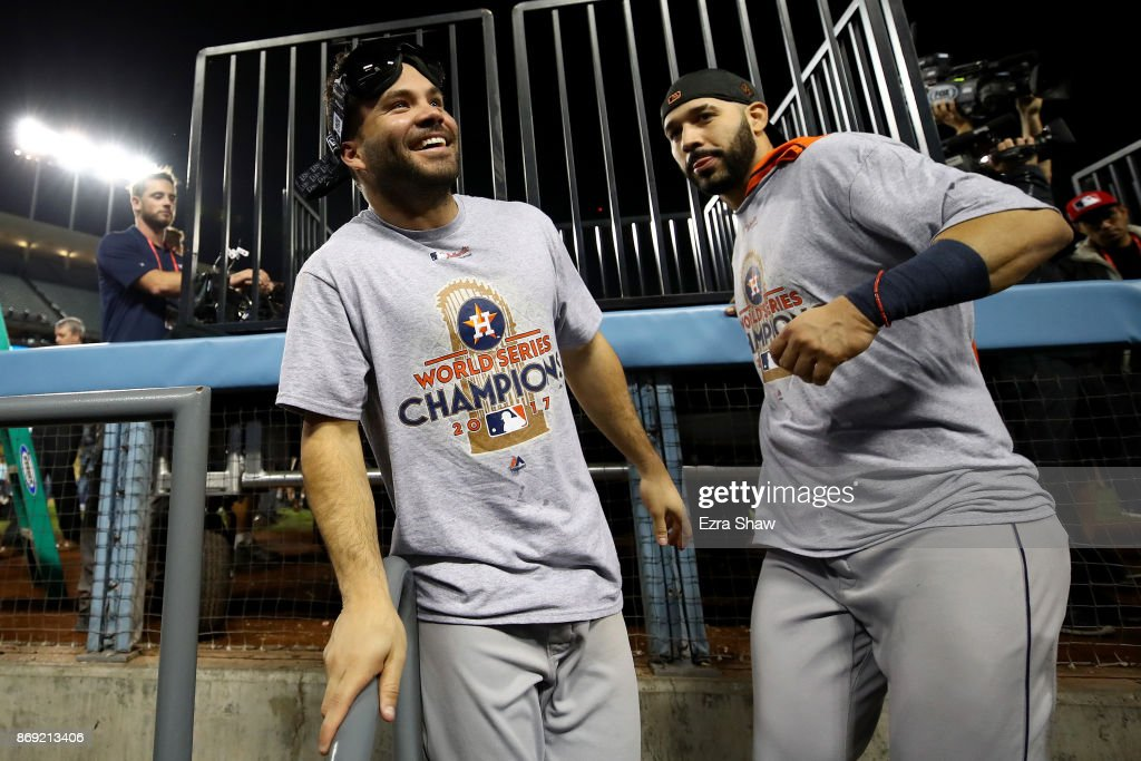 Jose Altuve #27 of the Houston Astros celebrates with Marwin Gonzalez #9 after defeating the Los Angeles Dodgers 5-1 in game seven to win the 2017 World Series at Dodger Stadium on November 1, 2017 in Los Angeles, California.