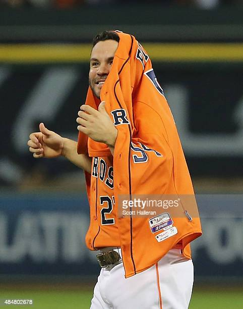 Jose Altuve of the Houston Astros celebrates with the jersey of Mike Fiers after Fiers tossed a nohitter en route to the Astros defeating the Los...