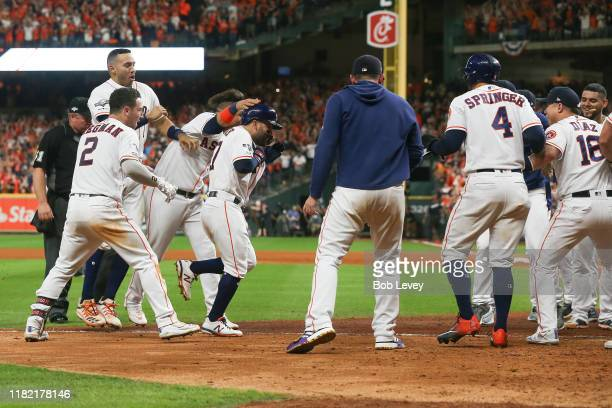 Jose Altuve of the Houston Astros comes home to score after his walk-off two-run home run to win game six of the American League Championship Series...