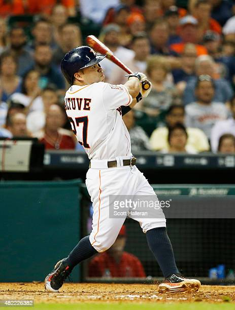 Jose Altuve of the Houston Astros connects on a tworun double in the sixth inning of their game against the Los Angeles Angels of Anaheim at Minute...