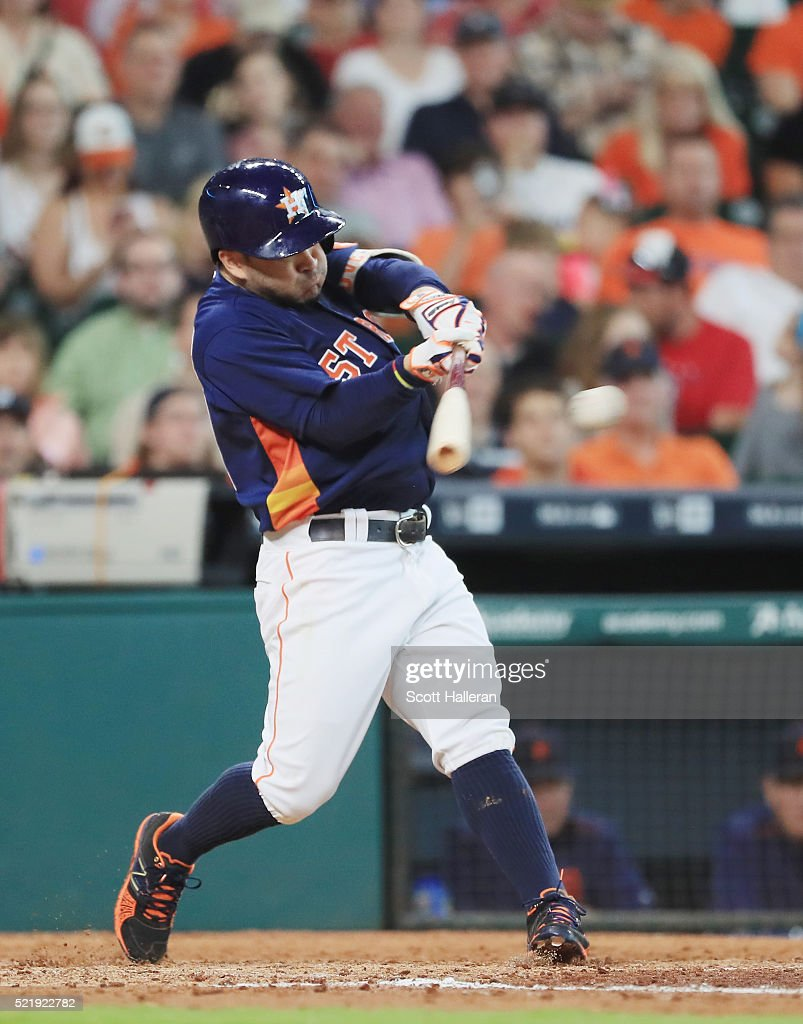 Jose Altuve #27 of the Houston Astros connects on a two-run single during the fourth inning of their game against the Detroit Tigers at Minute Maid Park on April 17, 2016 in Houston, Texas.