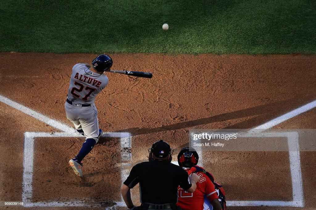 Jose Altuve #27 of the Houston Astros doubles during the first inning of a game against the Los Angeles Angels of Anaheim at Angel Stadium on May 16, 2018 in Anaheim, California.