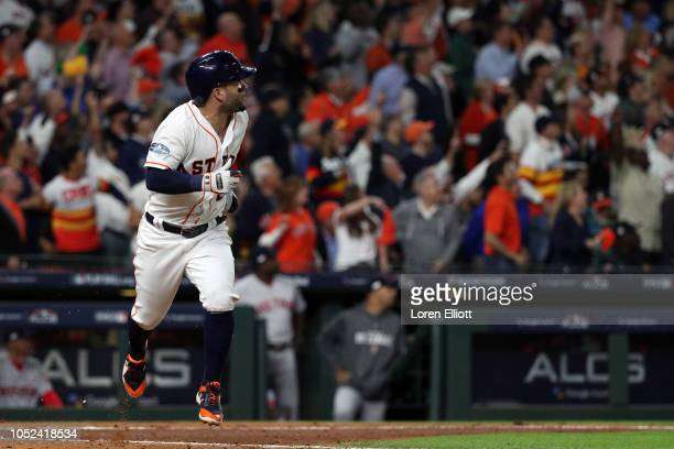 Jose Altuve of the Houston Astros doubles in the third inning during Game 4 of the ALCS against the Boston Red Sox at Minute Maid Park on Wednesday...