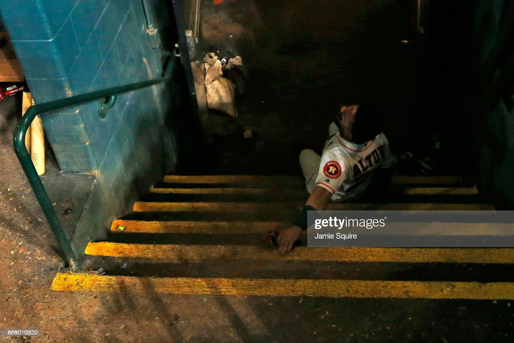 Jose Altuve #27 of the Houston Astros falls down stairs in the dugout after defeating the Los Angeles Dodgers in game five of the 2017 World Series at Minute Maid Park on October 30, 2017 in Houston, Texas. The Astros defeated the Dodgers 13-12.