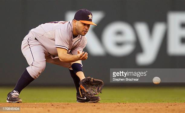 Jose Altuve of the Houston Astros fields a ground ball during a game against the Seattle Mariners at Safeco Field on June 11 2013 in Seattle...