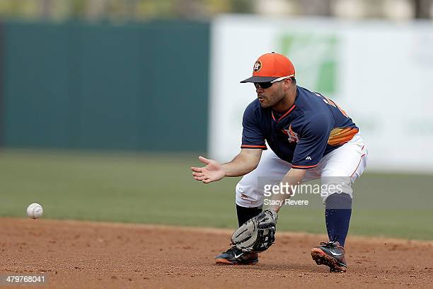 Jose Altuve of the Houston Astros fields a ground ball in the second inning of a game against the Philadelphia Phillies at Osceola County Stadium on...