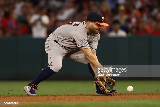 Jose Altuve of the Houston Astros fields a ground ball in the third inning during the MLB game against the Los Angeles Angels of Anaheim at Angel...